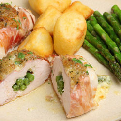 Chicken breasts stuffed with green beans and cheese wrapped in Parma ham.